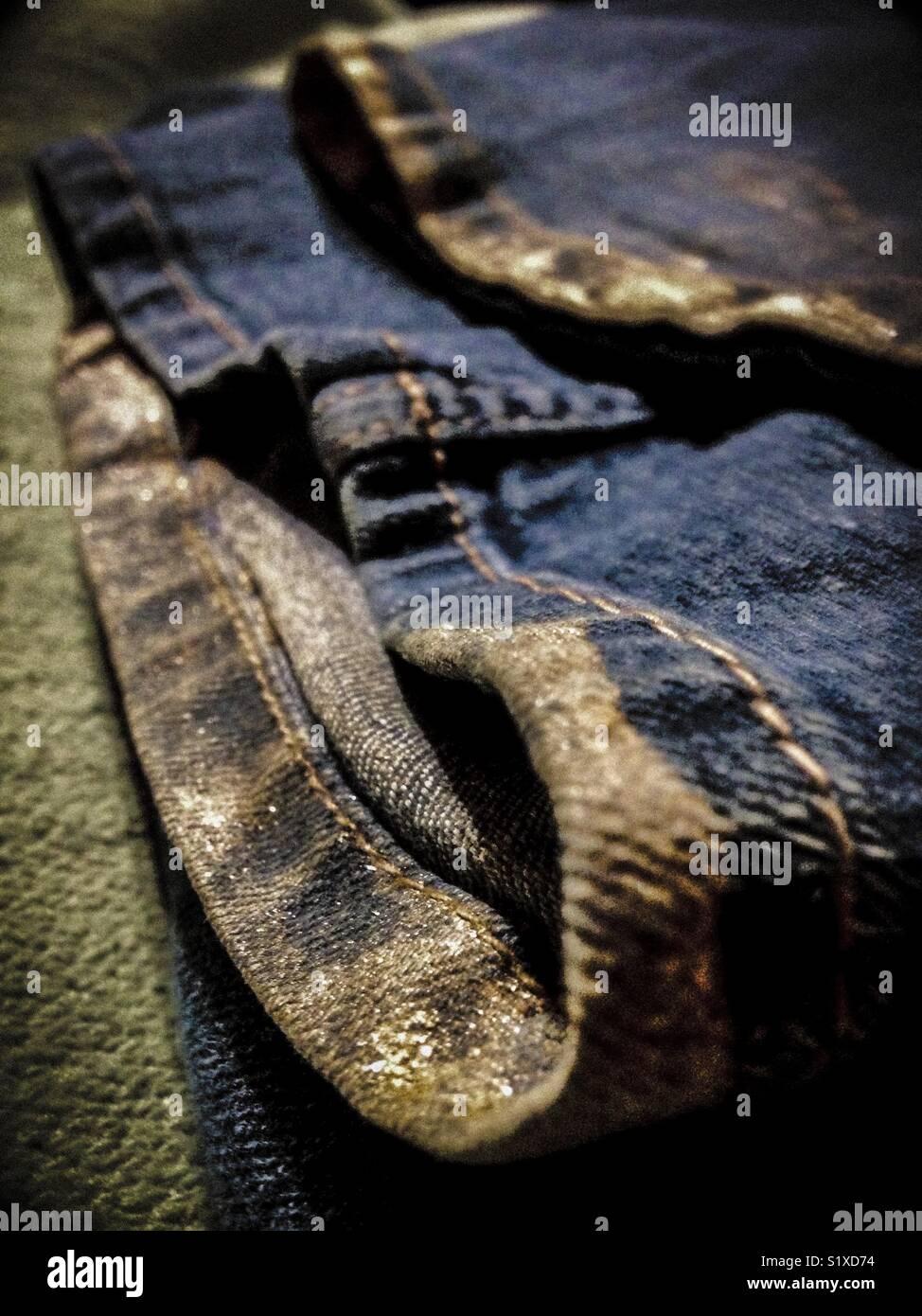 Shimmer of mica on muddy hem - Stock Image