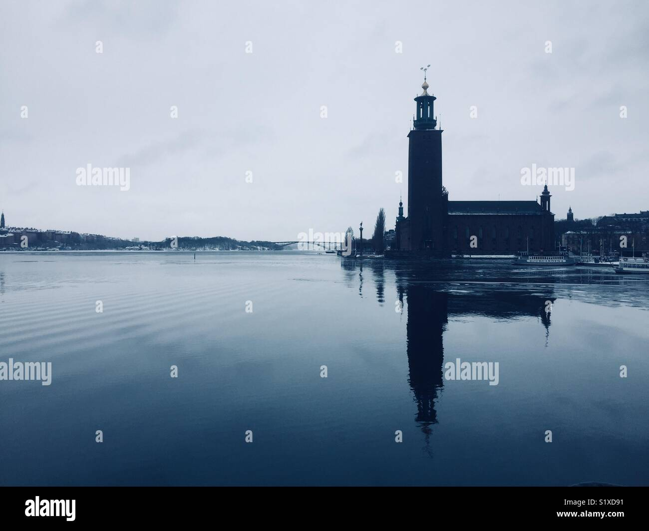 Stockholm town hall, stadhuset, reflected in water - Stock Image