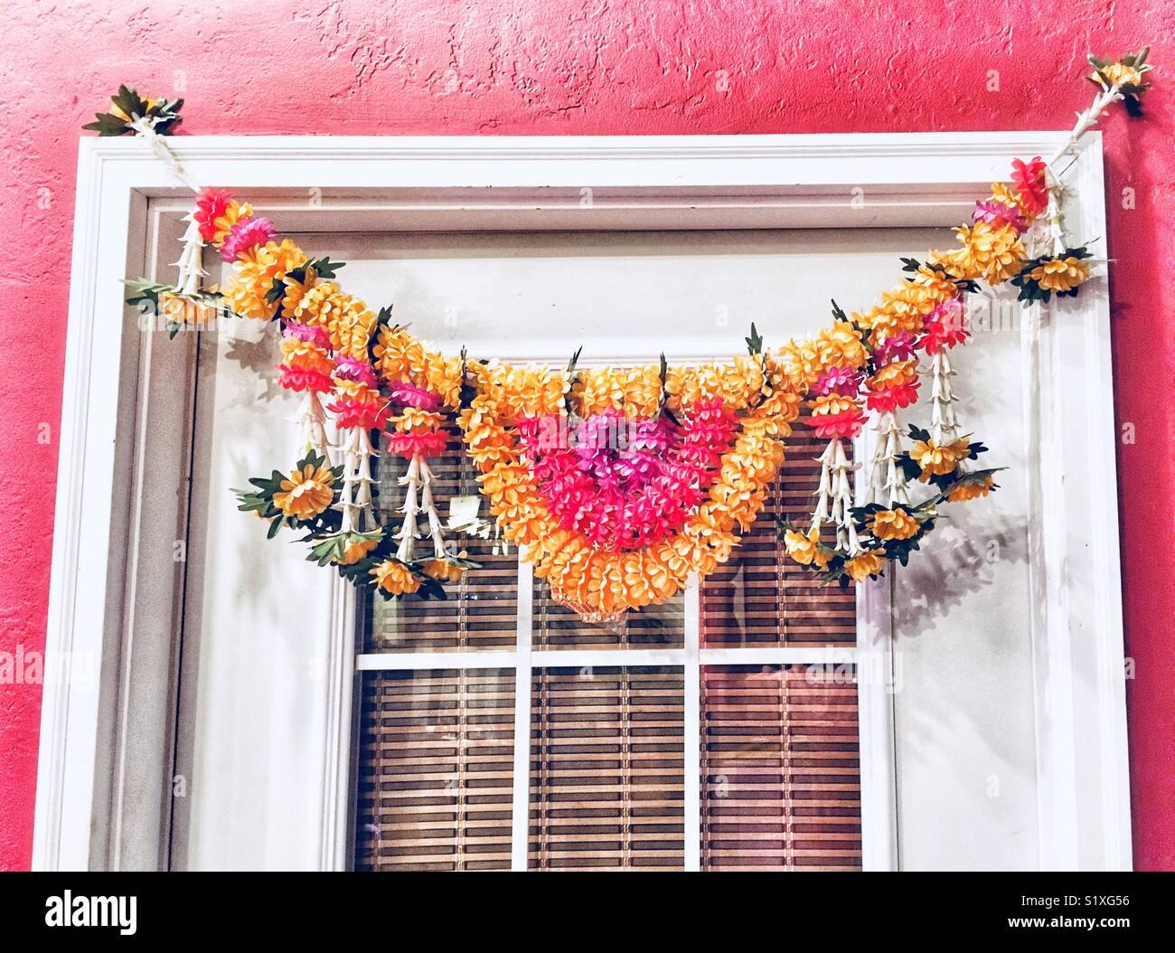 Flower Garland Over Door Of Asian Restaurant