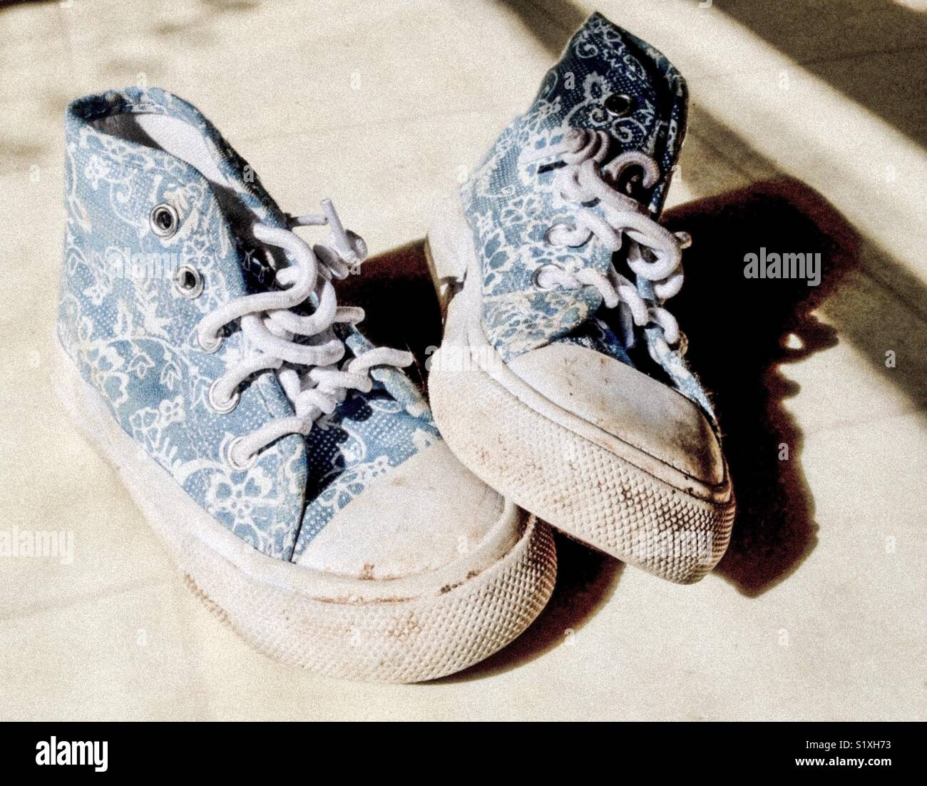 Scuffed toddler shoes - Stock Image