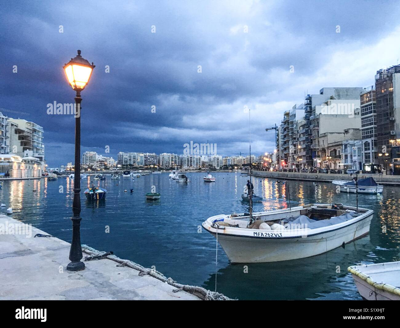 Stormy skies over Spinola Bay, St julians, Malta - Stock Image