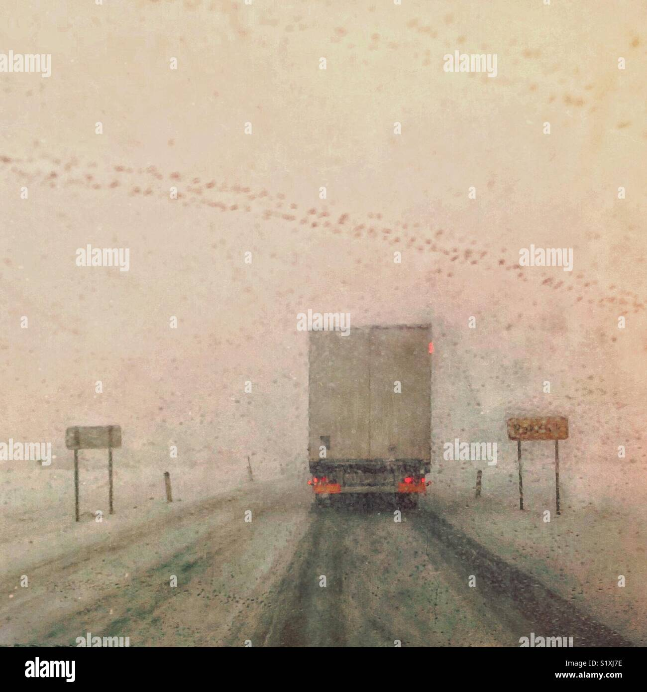 Car driving in heavy snow. A front window view of bad weather conditions - Stock Image