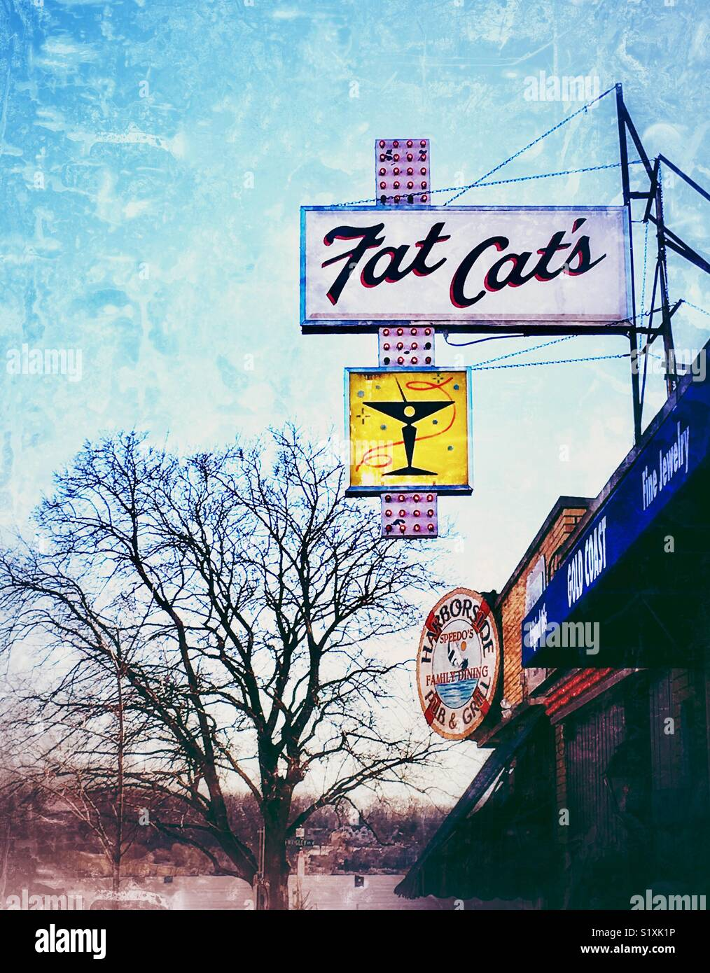 Billboard for Fat Cats bar next to gift shop and Harborside pub & grill in downtown Lake Geneva, WI - Stock Image