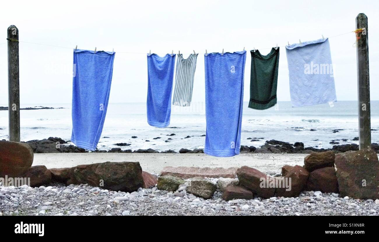 Blue towels on a washing line in Scotland, UK Stock Photo