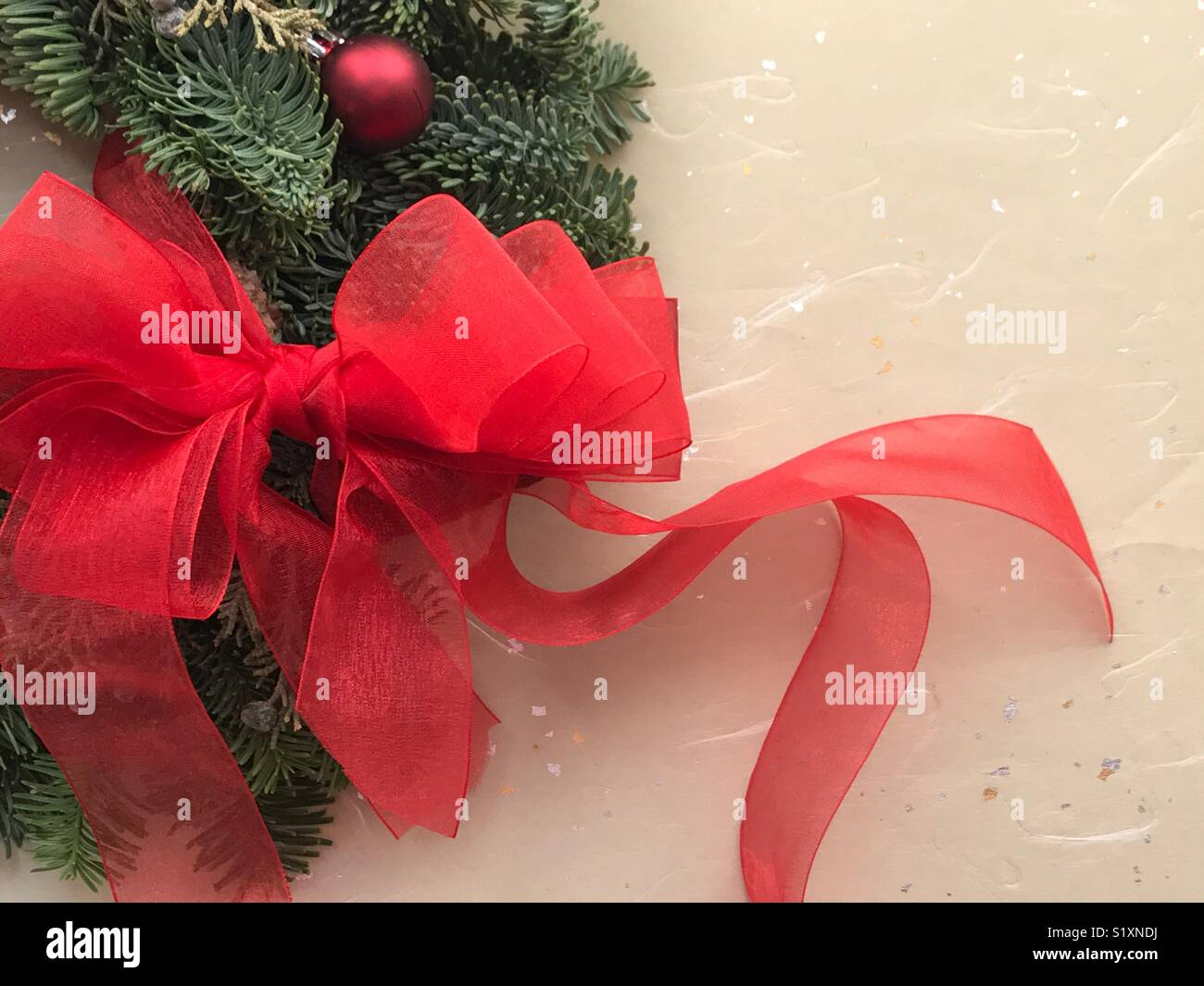Red bow on Christmas wreath with copy space Stock Photo