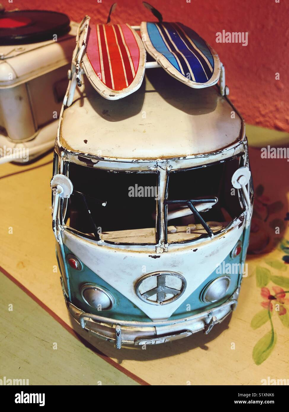 Vintage VW bus with a peace sign as a decoration. - Stock Image