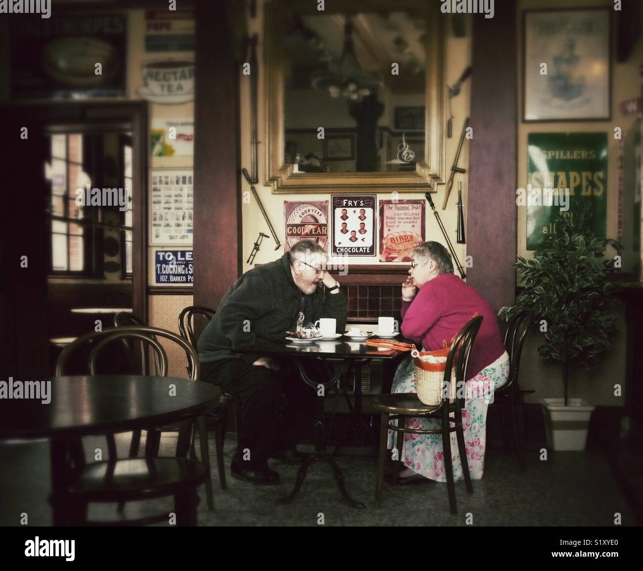 Couple having a cup of tea and a conversation in the Station Cafe, Bridlington, East Yorkshire, England, UK Stock Photo