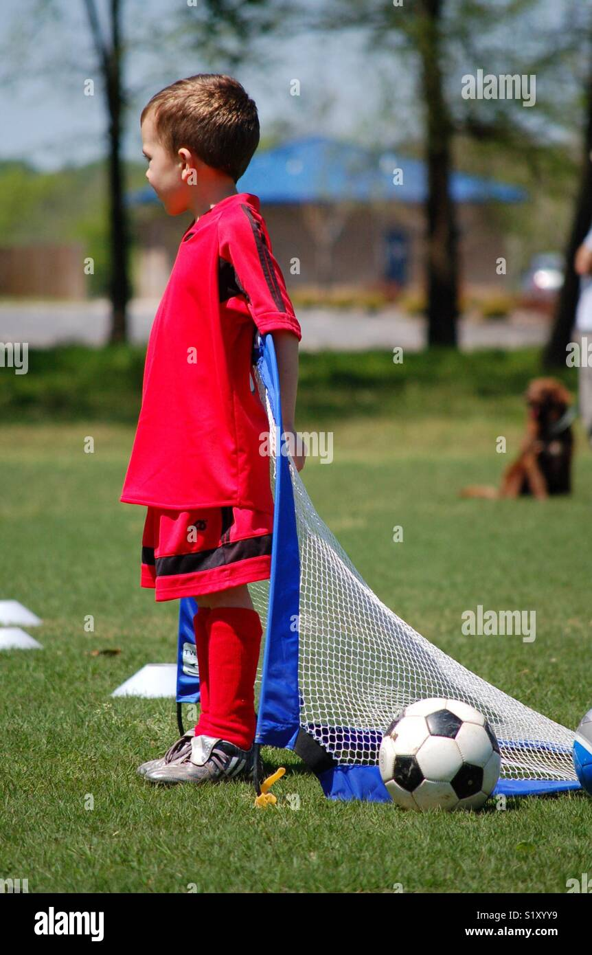 Child Goalie Playing Soccer - Stock Image
