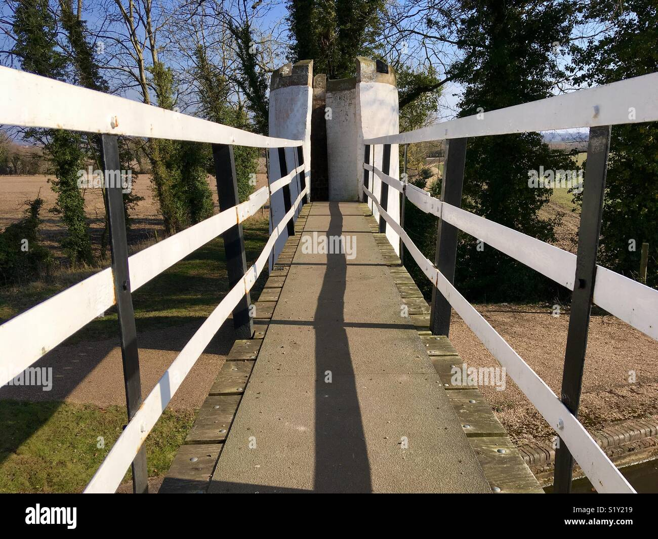 Architecturally quirky footbridge over a canal - Stock Image