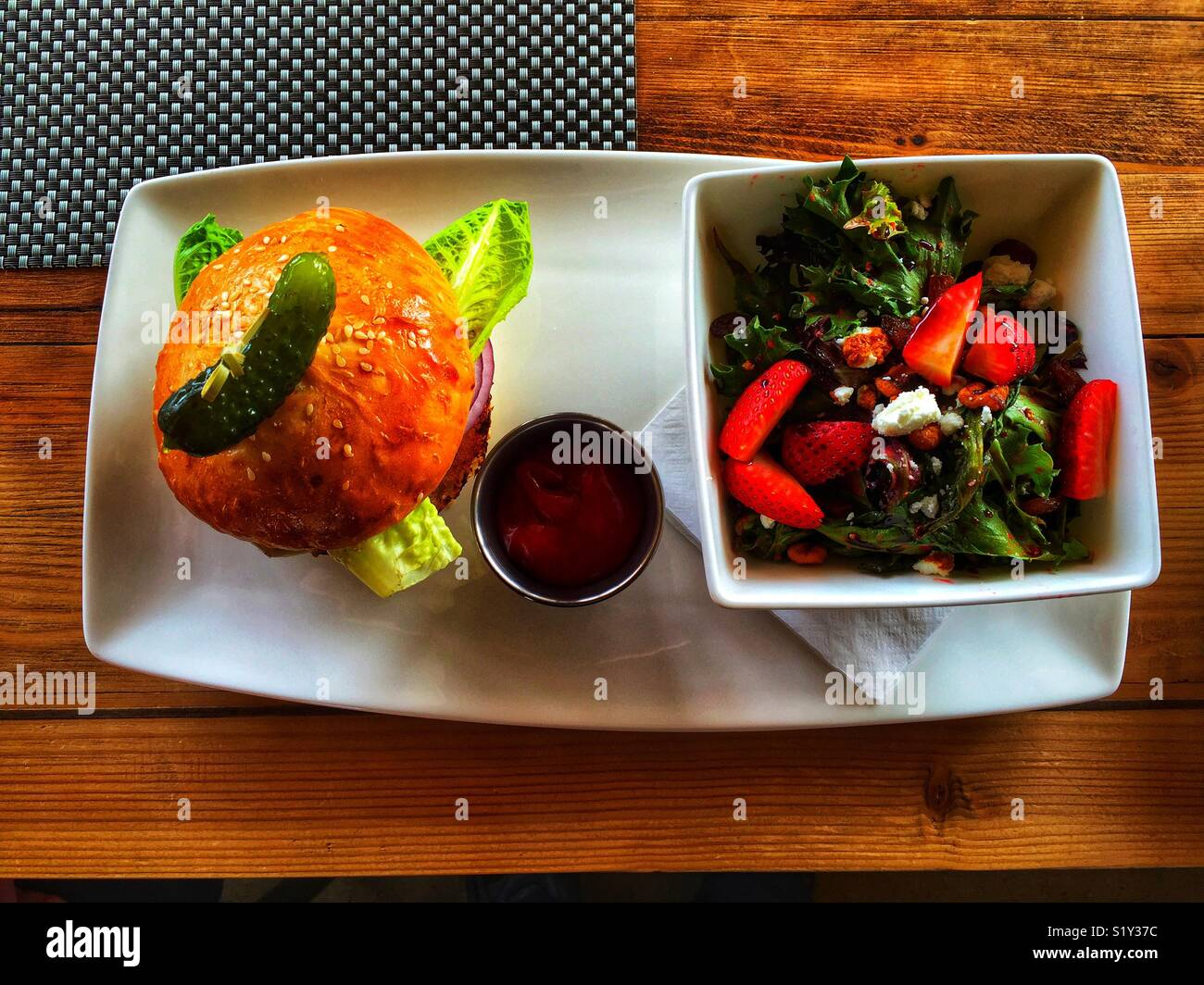 Bison burger and salad - Stock Image
