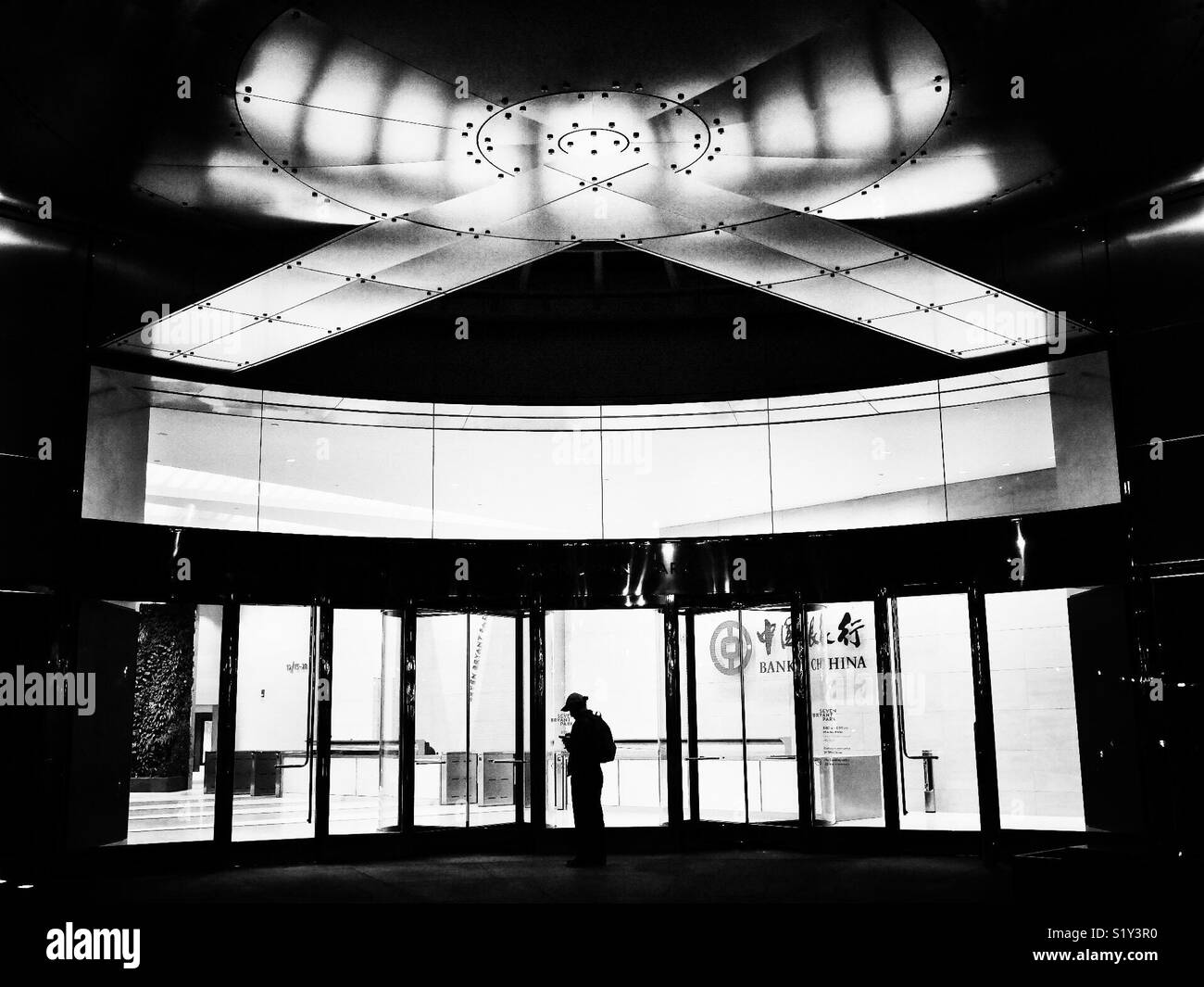 Silhouette of man standing outside of Bank of China in New York City, USA Stock Photo