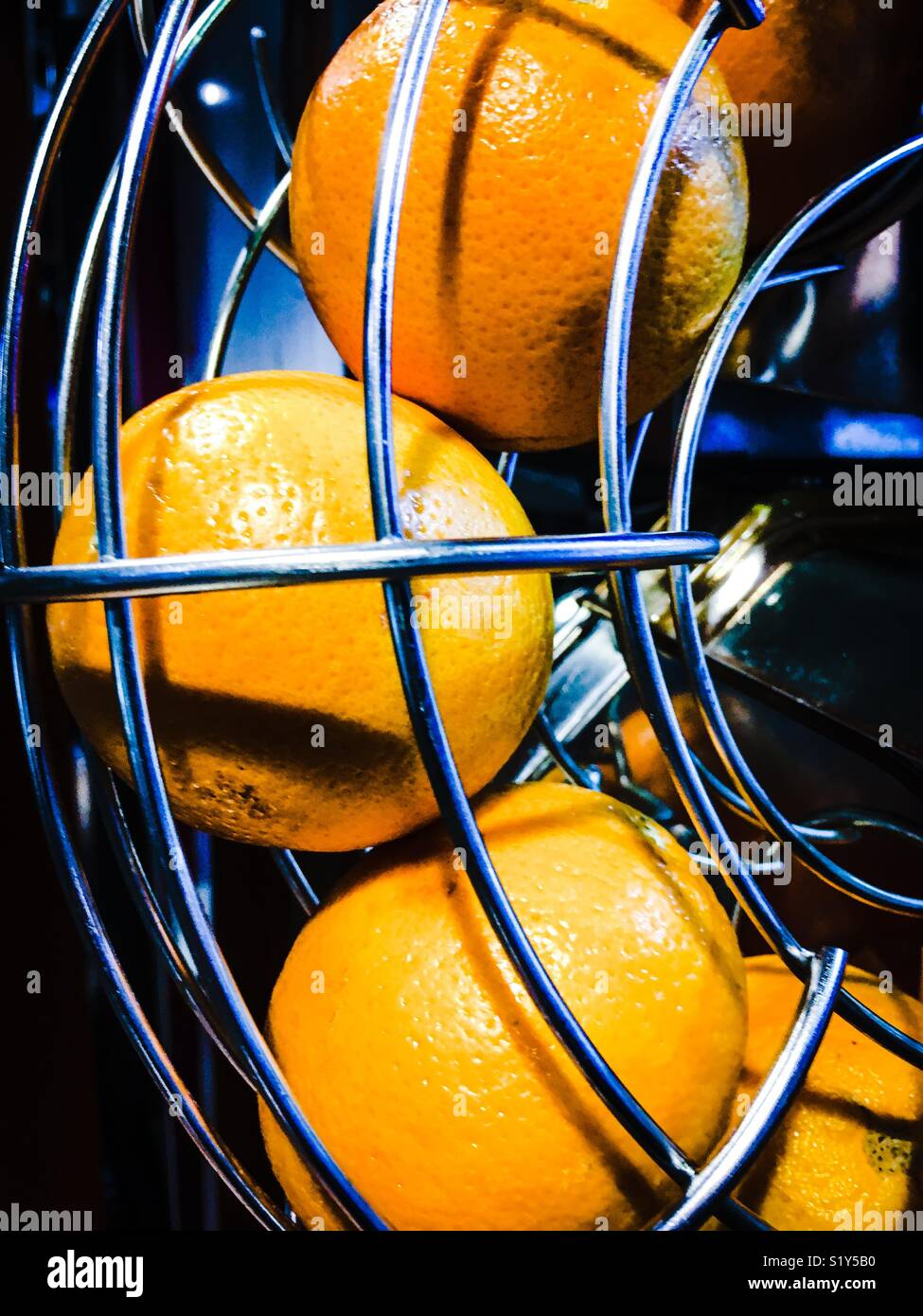 Oranges in Juicer Stock Photo