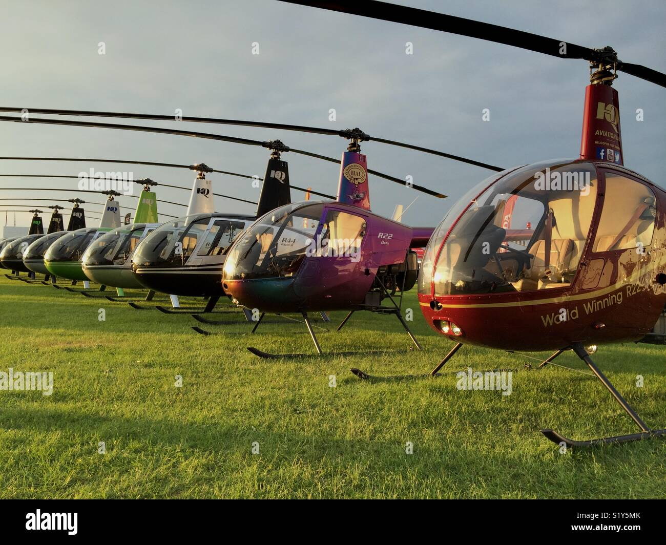 Robinson helicopters parked in a row - Stock Image