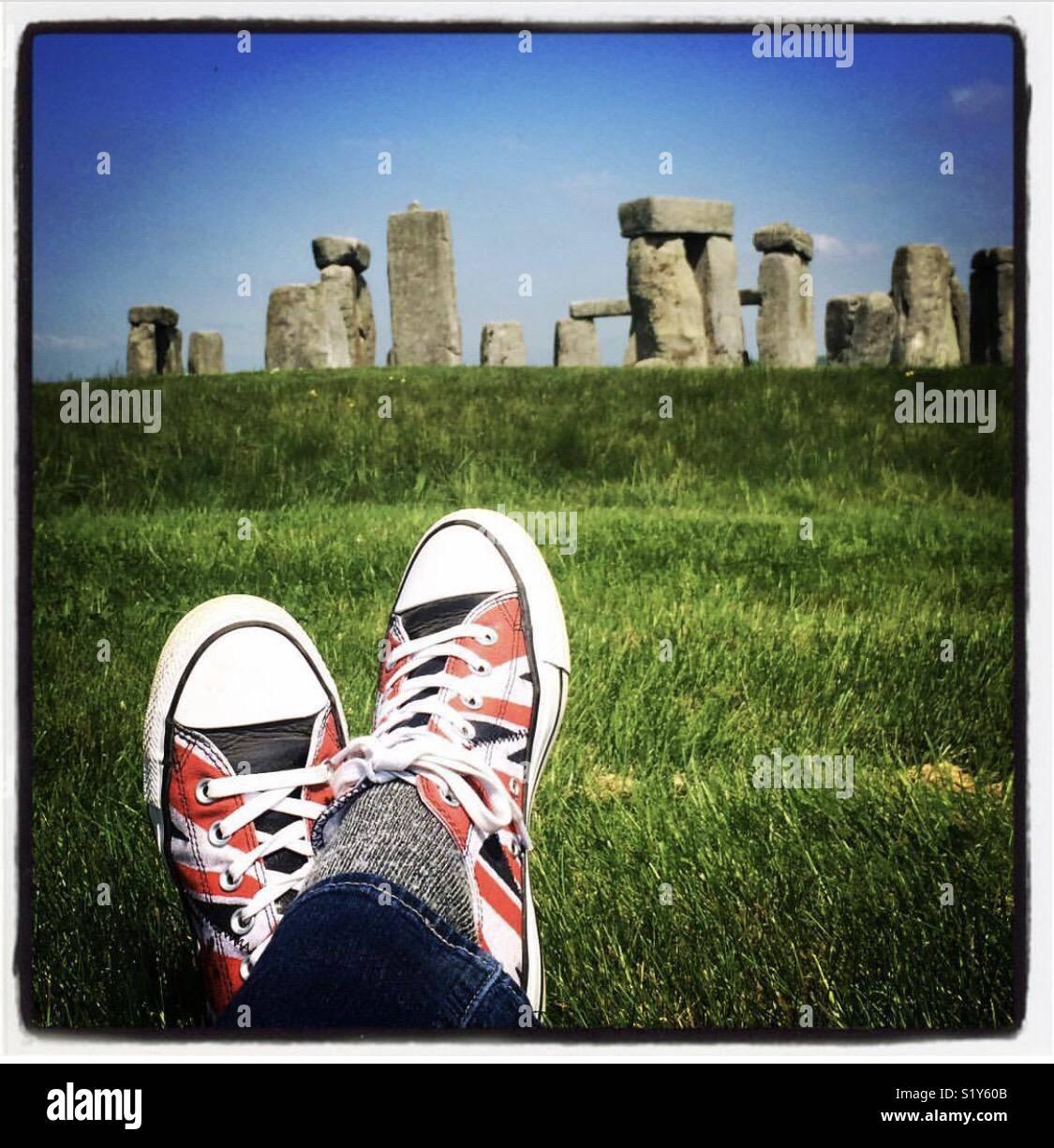 Union Jack Converse running shoes at Stonehenge - Stock Image