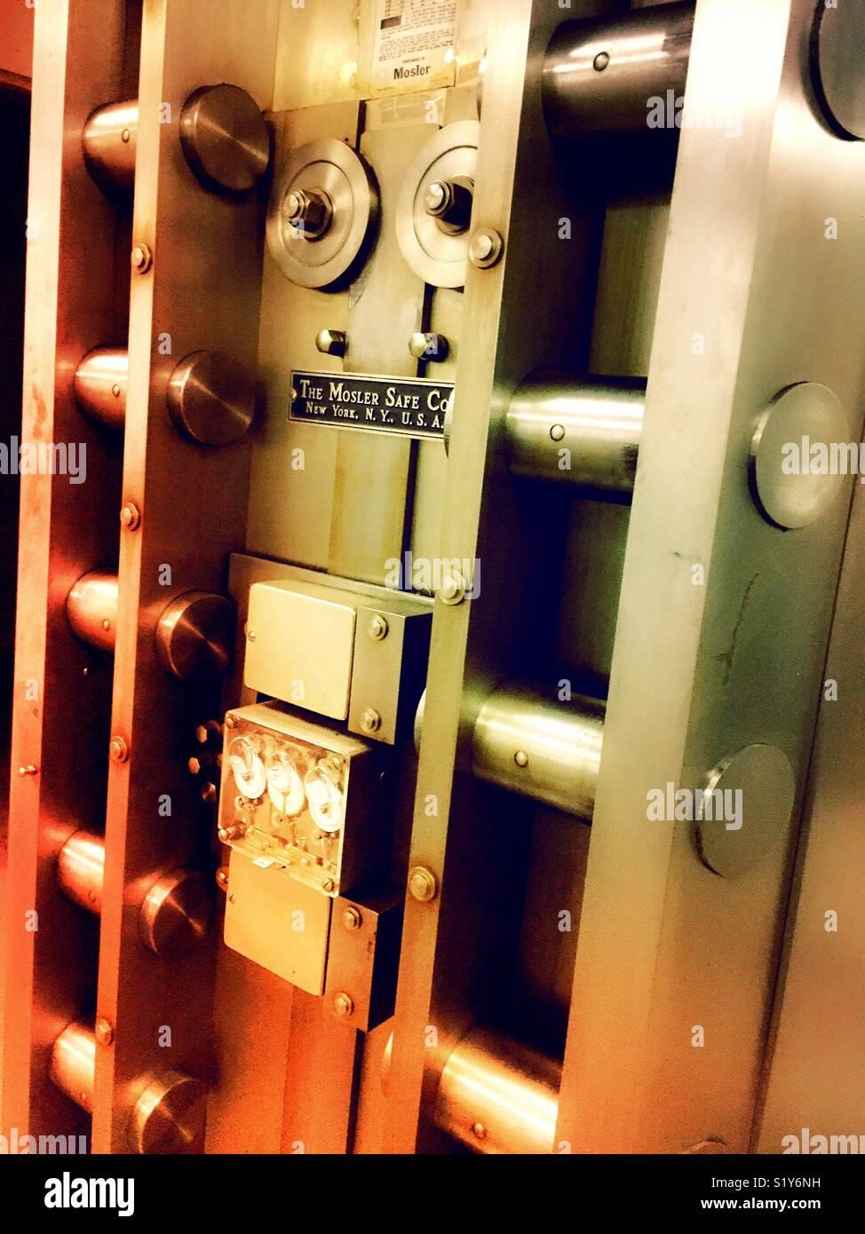 Vault locking mechanism on the inside of a large safe door, USA - Stock Image