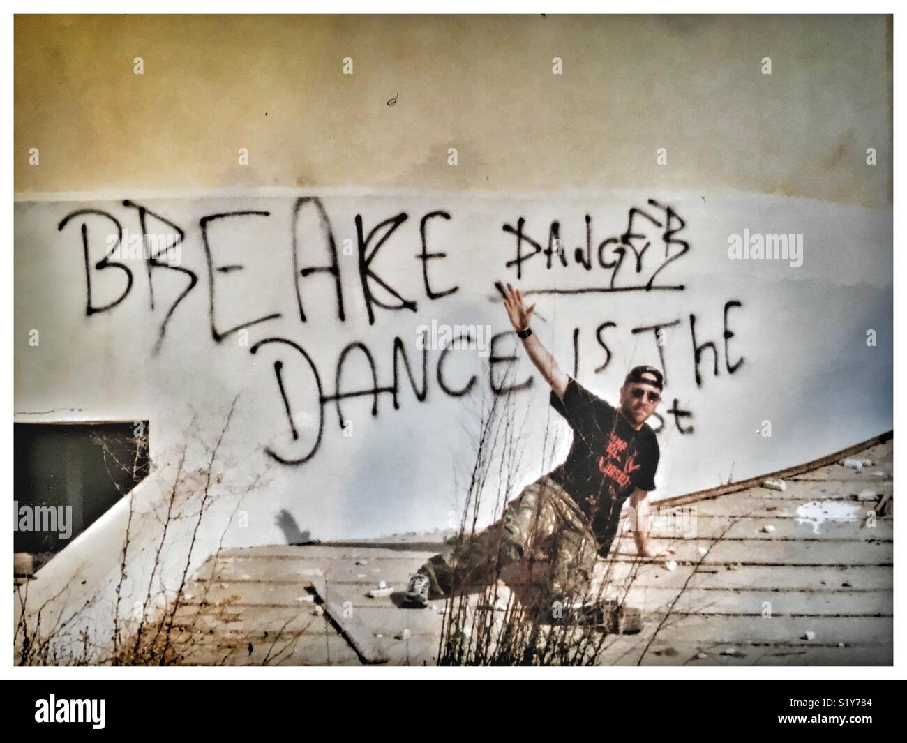 Breake Dance Is The Best (sic) B-Boy dancing in front of graffiti on a wall. Stock Photo