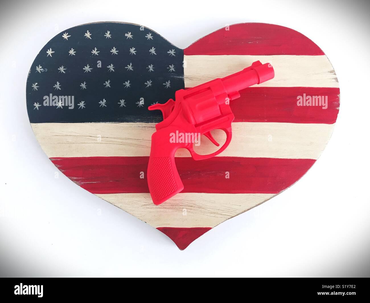 Conceptual: guns in America. - Stock Image