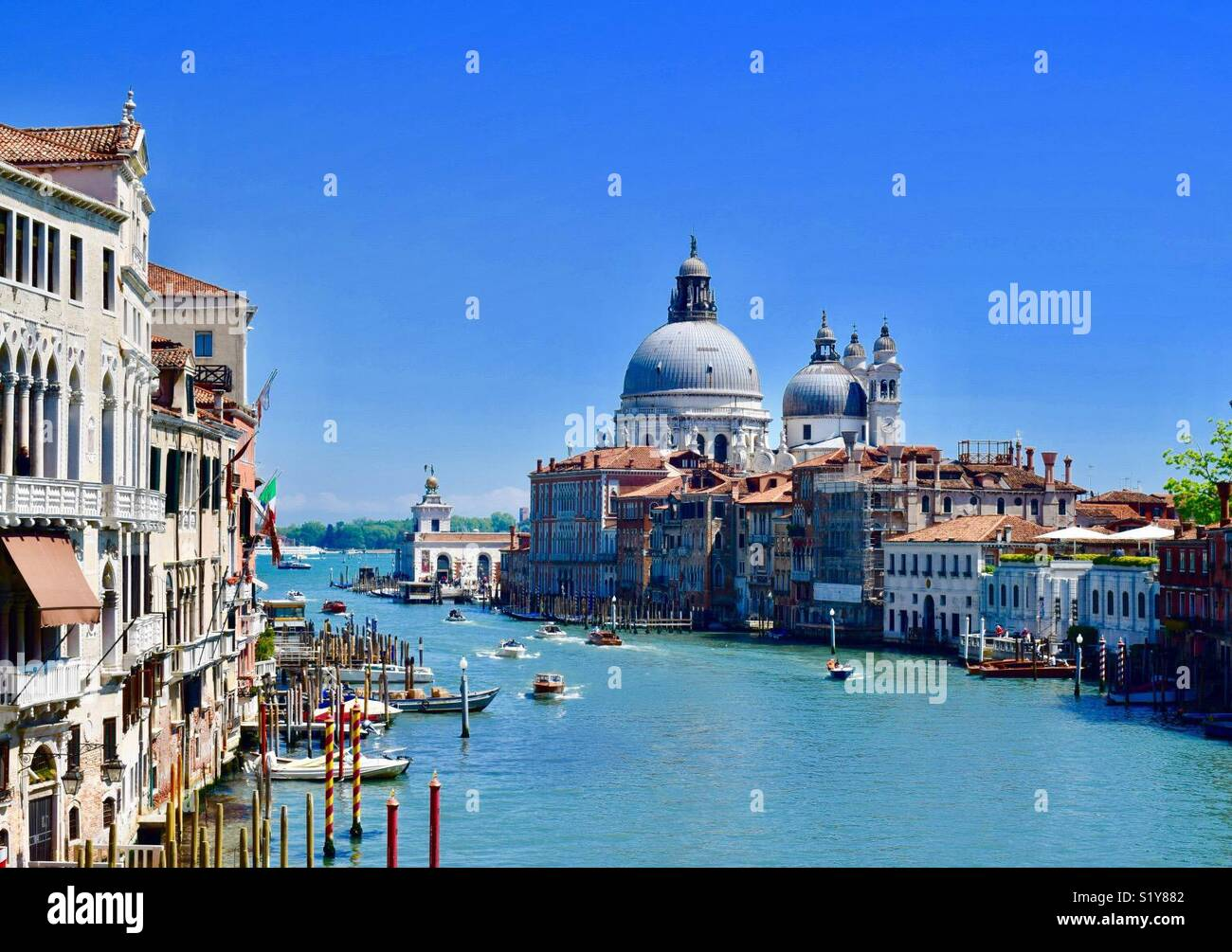 View of the Grand Canal and Santa Maria Della Salute from the Academia Bridge - Stock Image