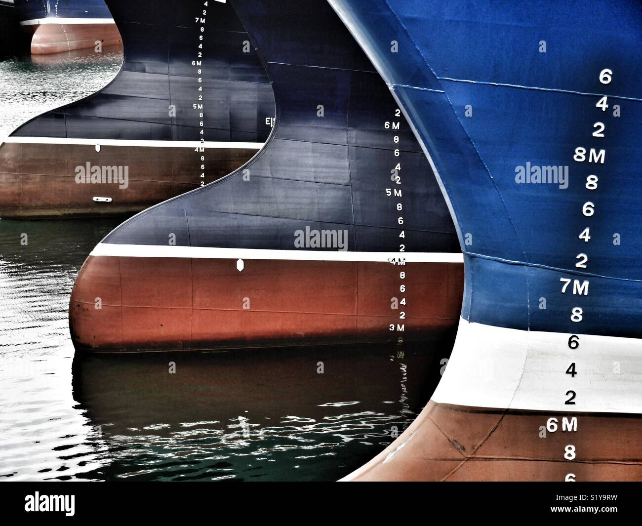 Low tide showing bows of fishing vessels whilst moored in harbour, Fraserburgh, Scotland, UK Stock Photo