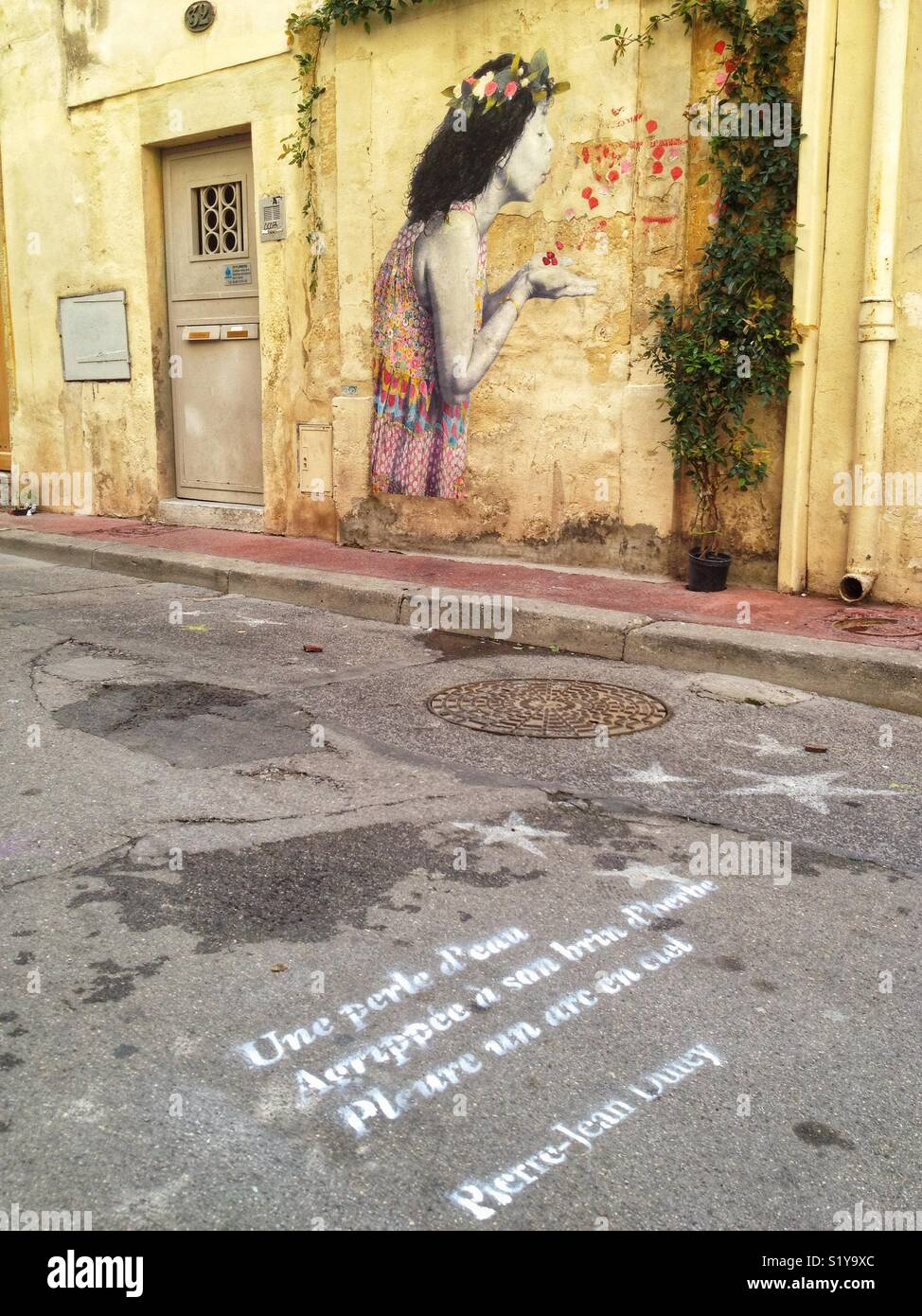 Graffiti and poetic sentence in a street, Montpellier France - Stock Image