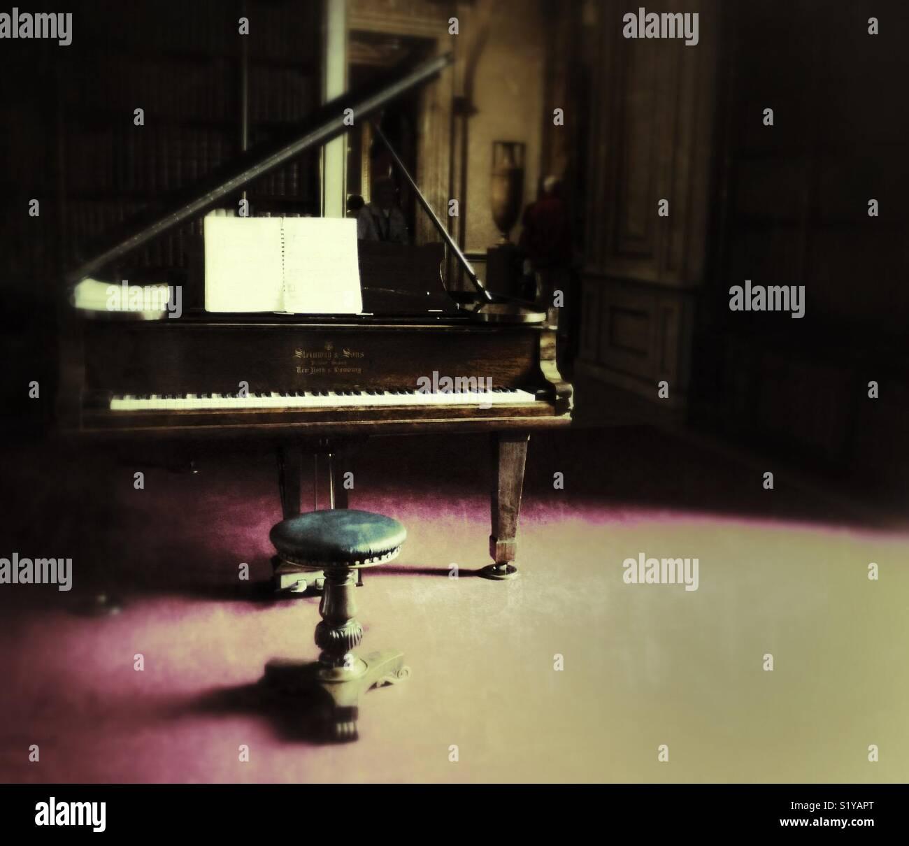 Grand piano and stool Stock Photo