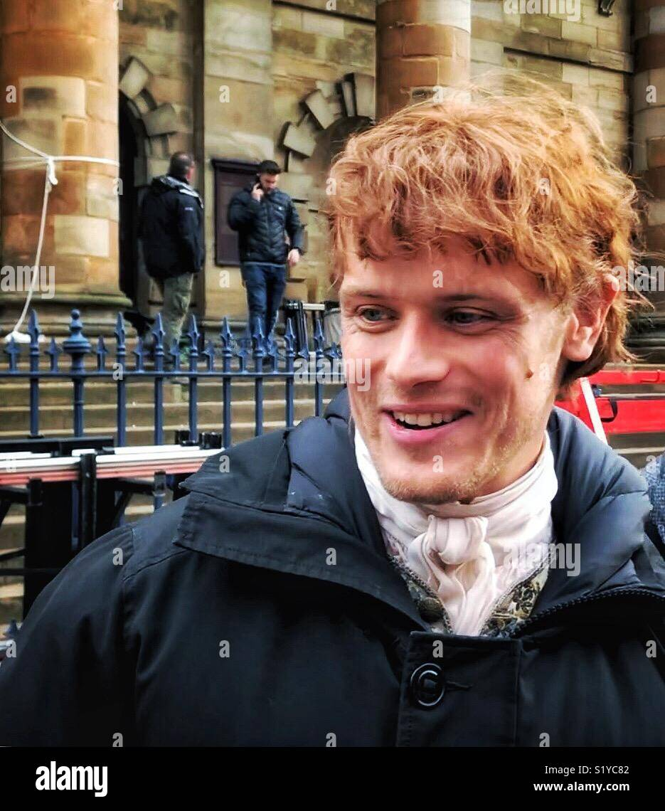 Outlander star Sam Heughan greeting fans while filming in Glasgow - Stock Image
