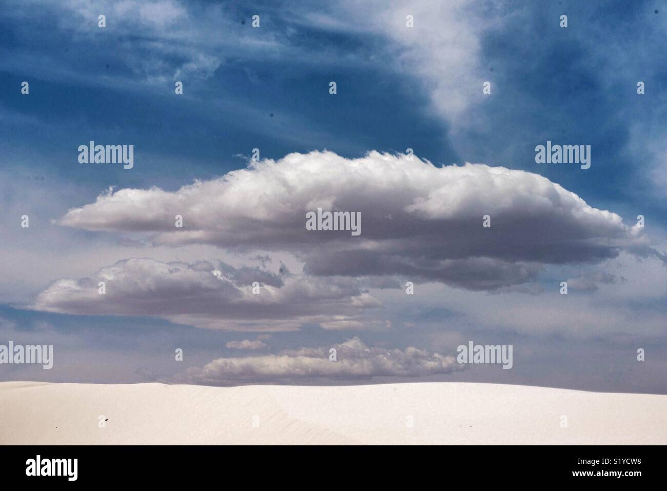 Clouds over White Sands, New Mexico - Stock Image