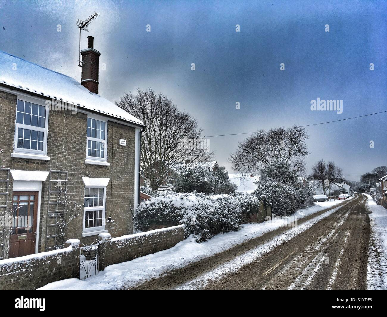 English village in the snow - Stock Image
