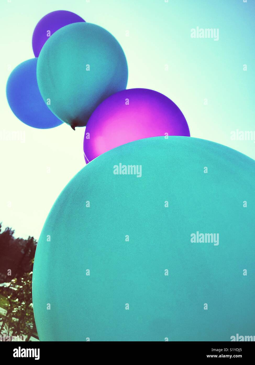chain of balloons reaching to the sky - Stock Image