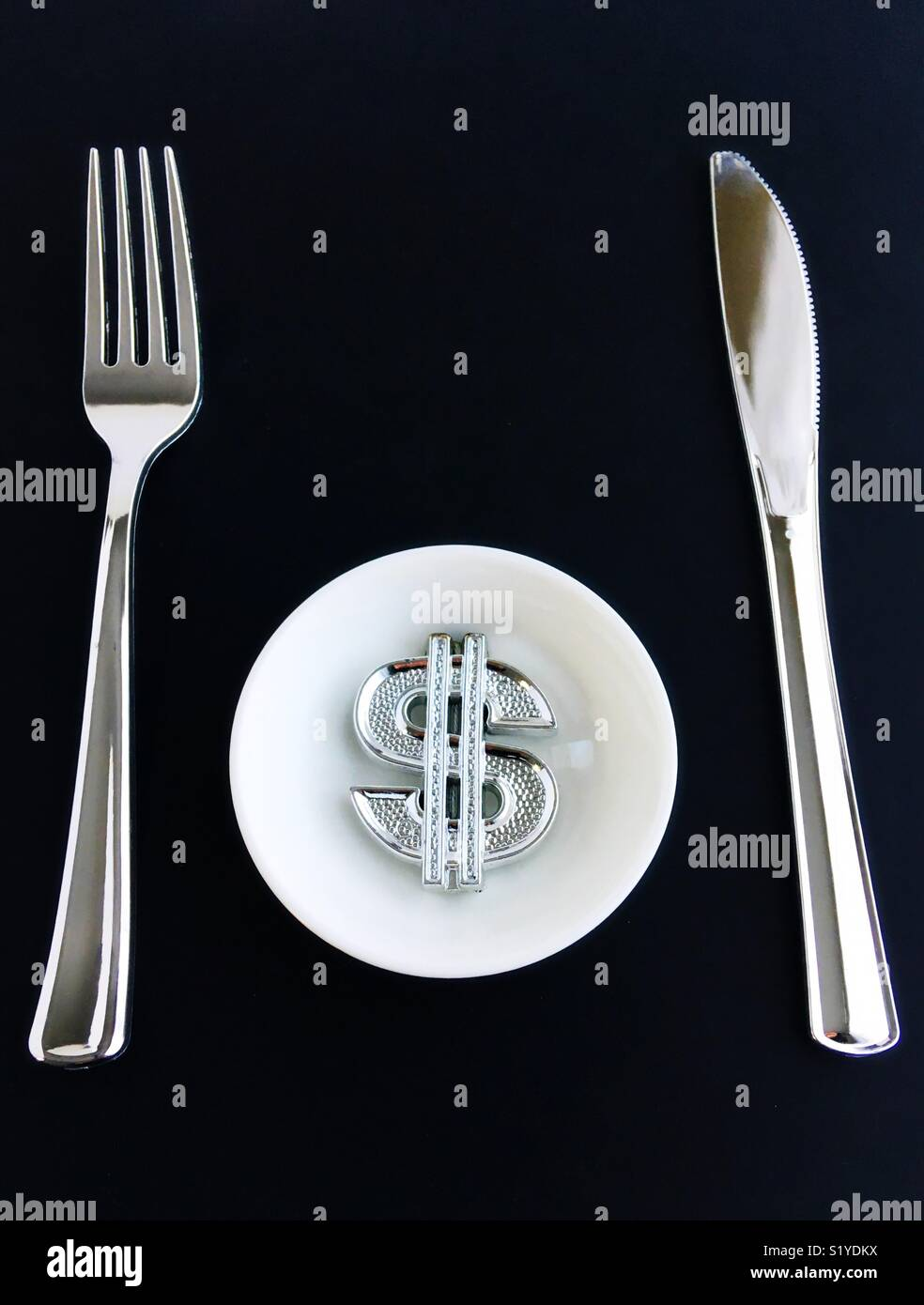 Conceptual: money hungry. - Stock Image