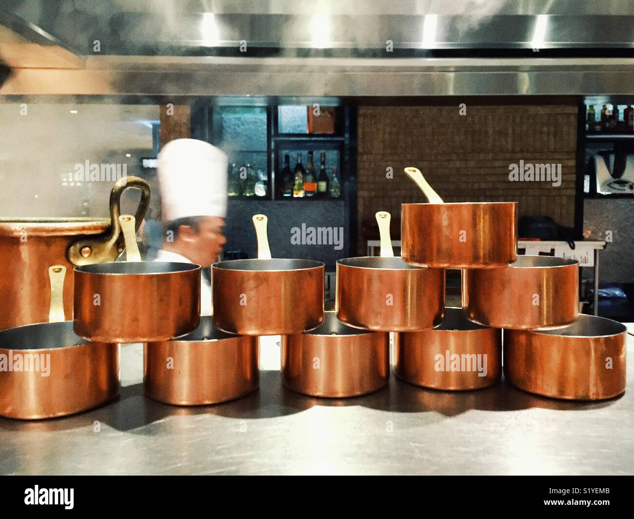 Row Of Copper Pots On The Counter In The Five Star Restaurant Kitchen In Sofitel Hotel In Manila Philippines Stock Photo Alamy