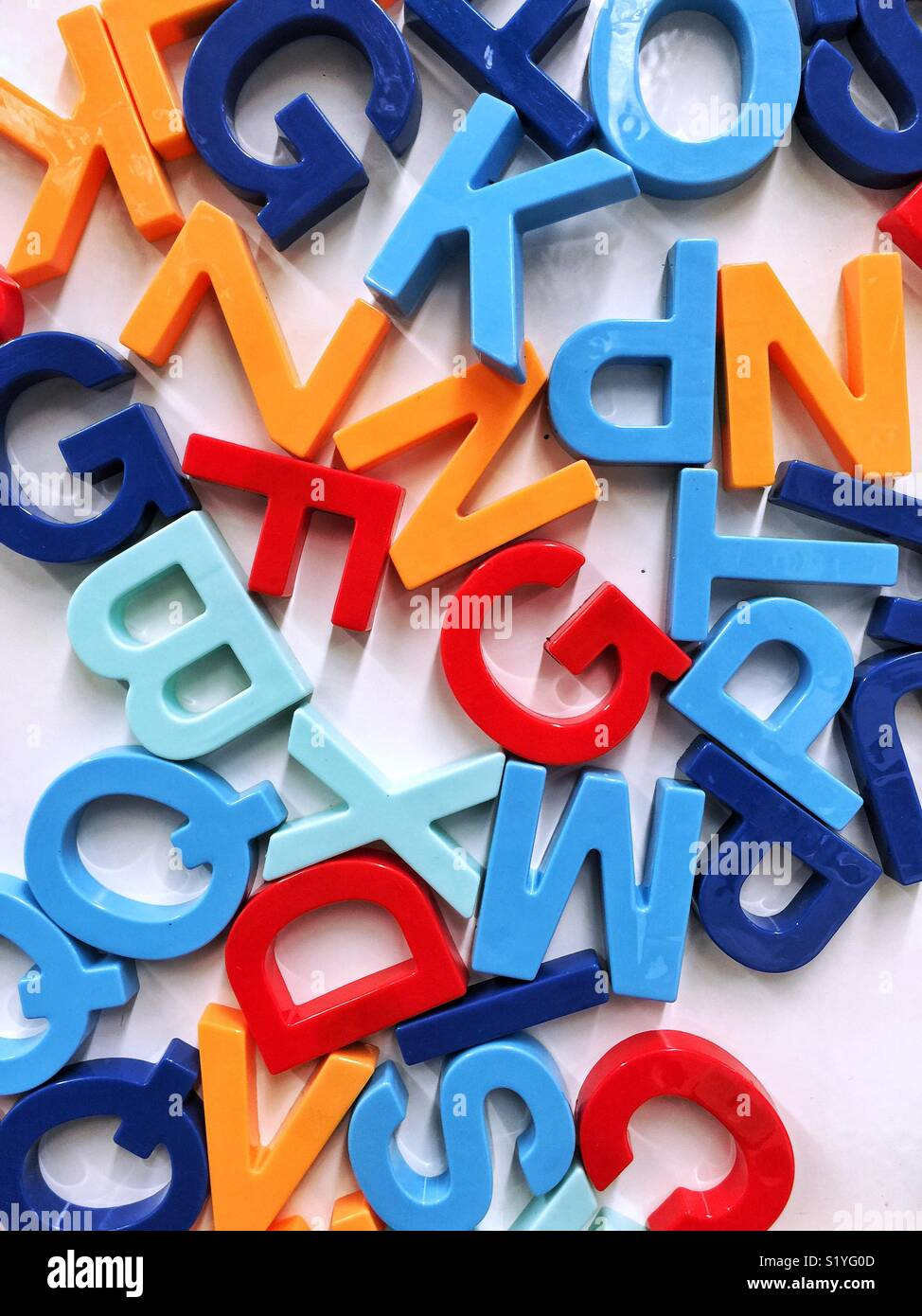 mixed up colorful magnetic letters