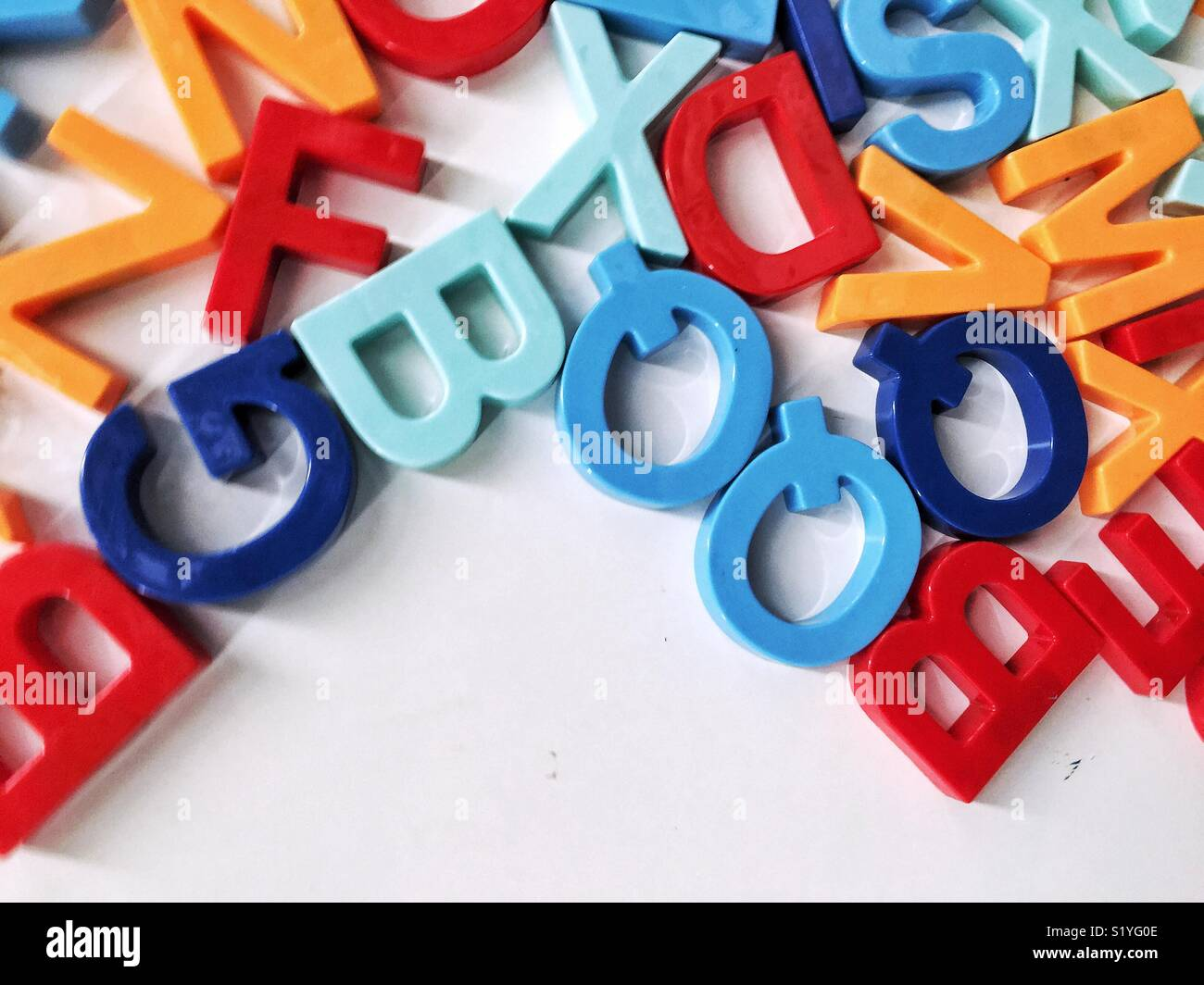 mixed up colorful magnetic letters with empty space for copy