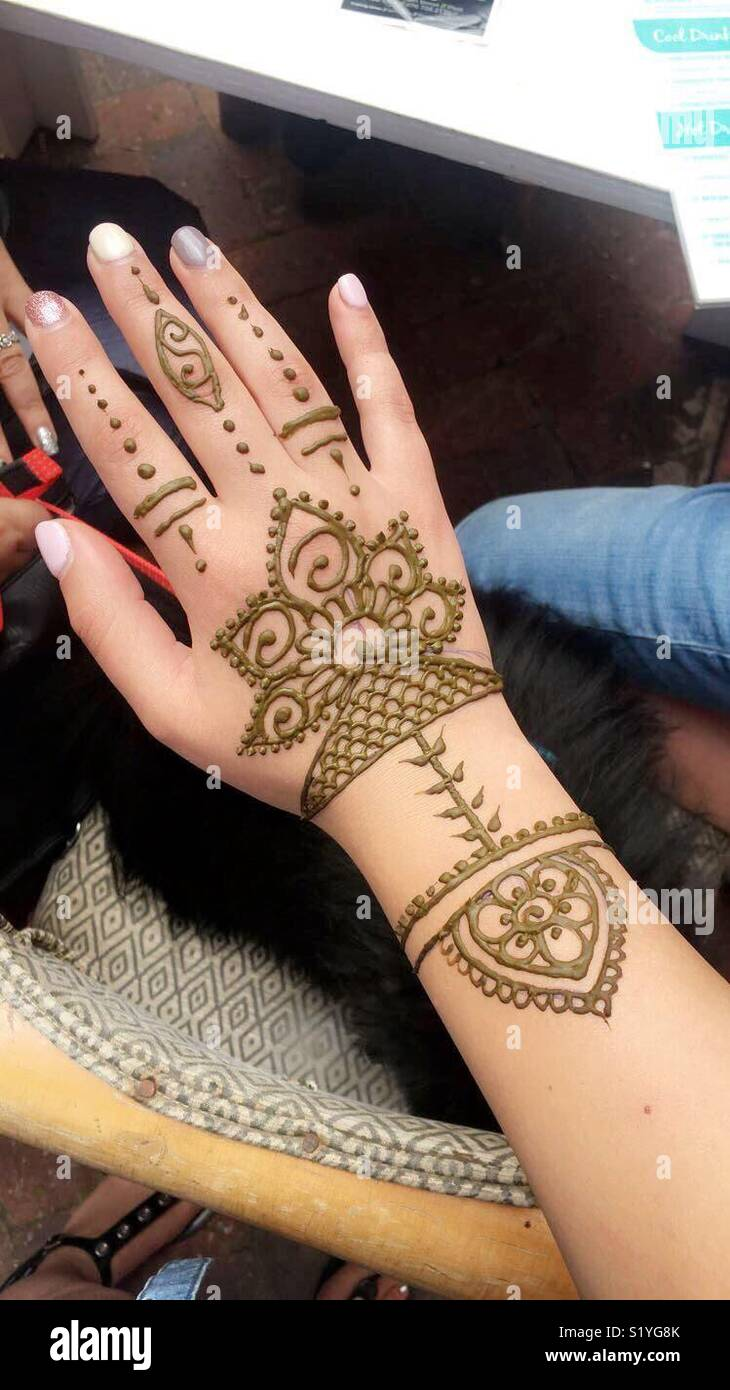 Henna tattoo on hand and arm in Plettenberg Bay, South
