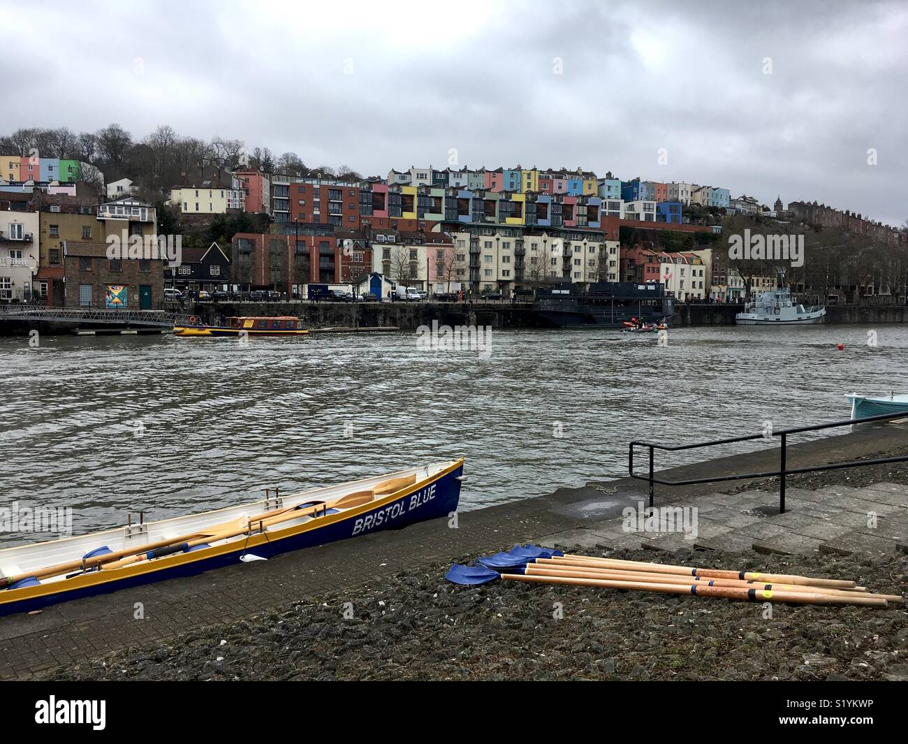 Bristol Blue gig rowing boat and oars at the ready in Bristol harbour for inter club gig racing. - Stock Image