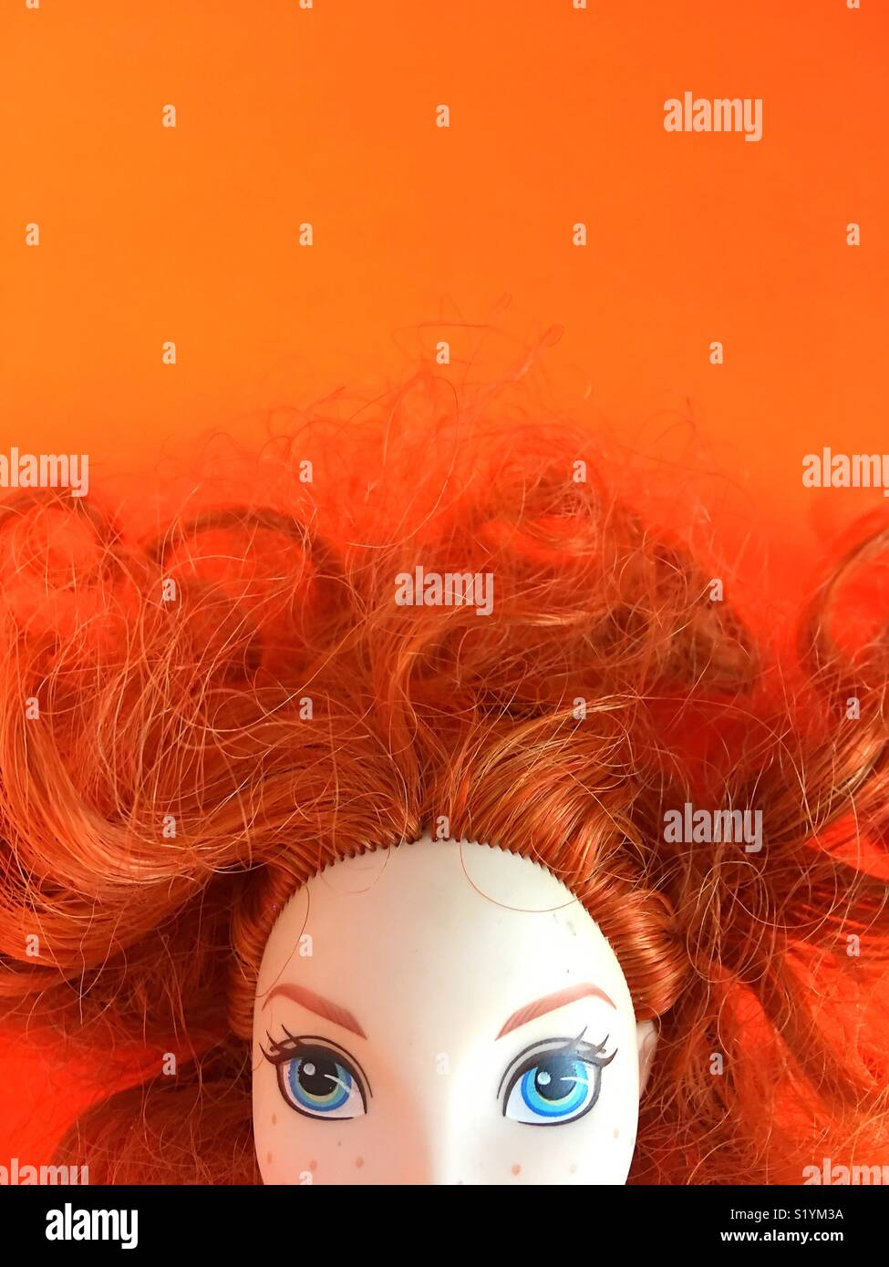Close up of doll  with red hair. - Stock Image
