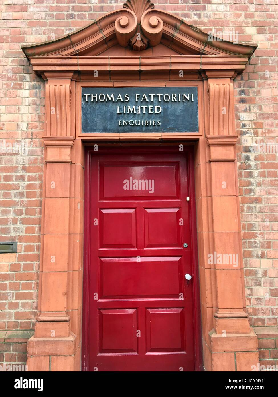 Carved terracotta entrance and red door Thomas Fattorini badge and medal maker Jewellery Quarter Birmingham UK & Carved terracotta entrance and red door Thomas Fattorini badge and ...