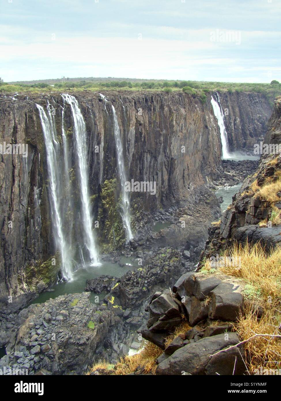 imposant view in empty canyon of the victorian falls in zimbabwe. its low water time - Stock Image