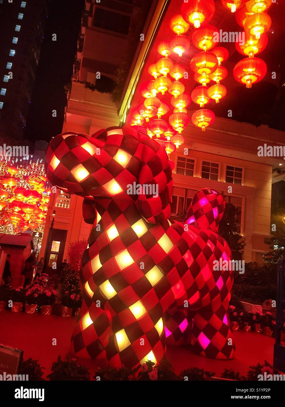 'Fortune Knot Doggie', a 4-meter sculpture by Kavan Lau installed at Lee Tung Avenue, Wan Chai, Hong Kong Island for the Chinese New Year of the Dog in 2018, emulates traditional weaving technique - Stock Image