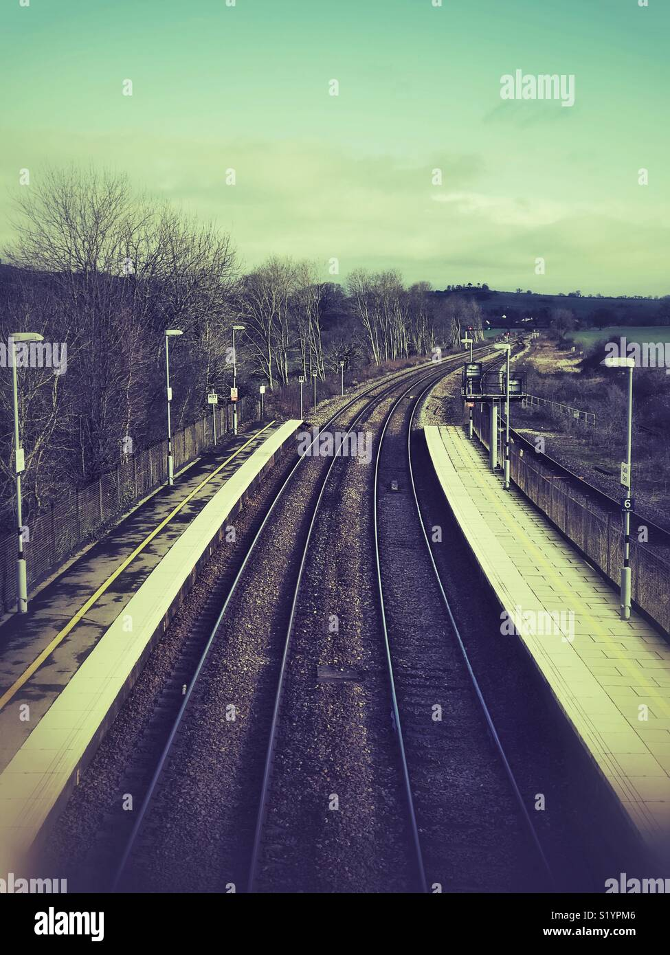 A train line stretching into the distance - Stock Image