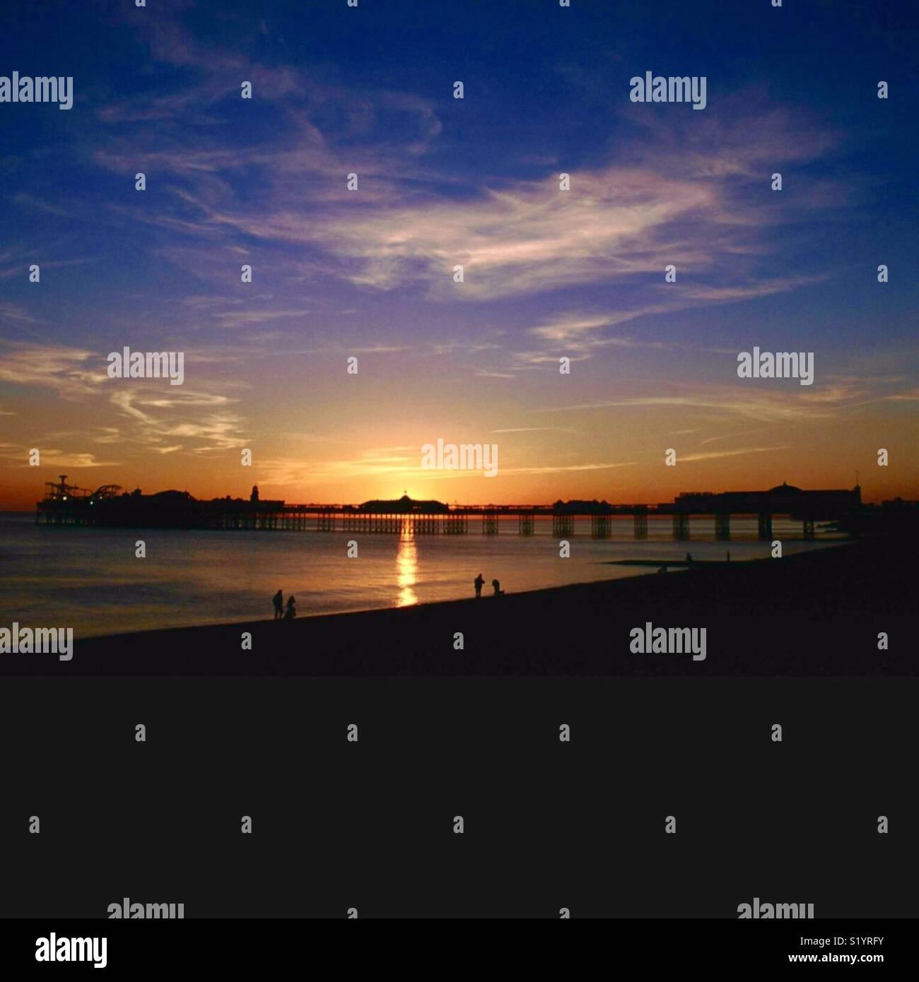 Sunset at Brighton Pier - Stock Image
