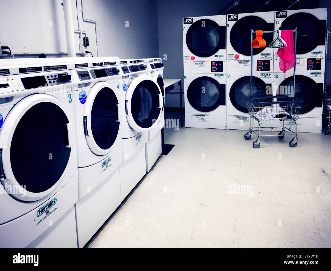 Frontloading washers and dryer's in a commercial laundromat, United States - Stock Image
