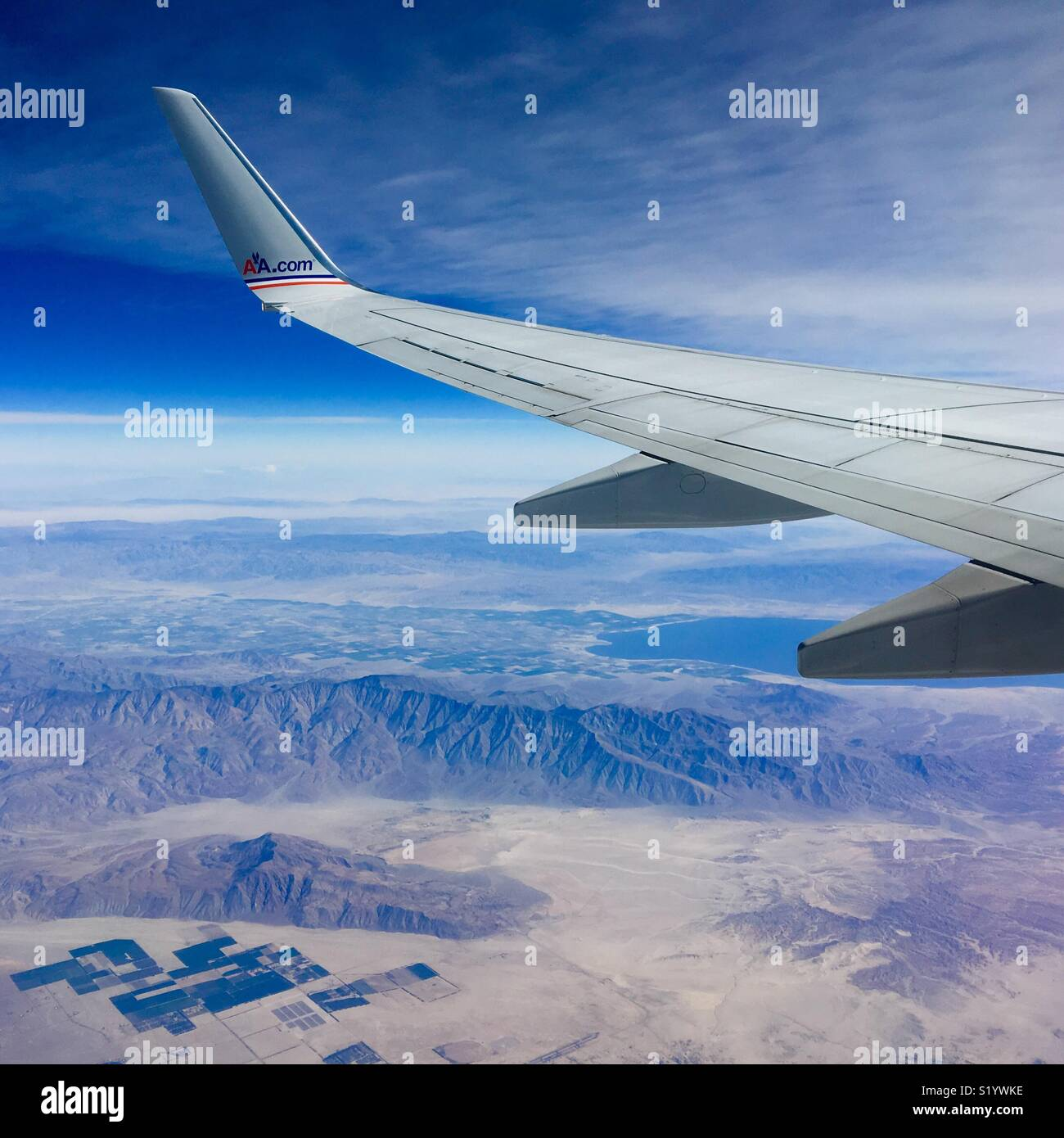 Flying over desert from Los Angeles to Mexico City on an American Airlines flight - Stock Image