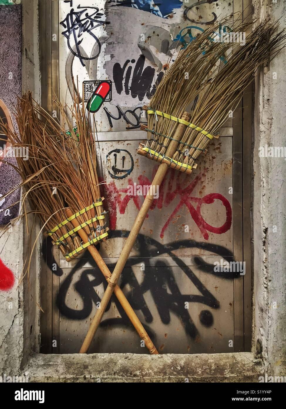 Traditional Chinese brooms and graffiti, Sai Ying Pun, Hong Kong Island Stock Photo
