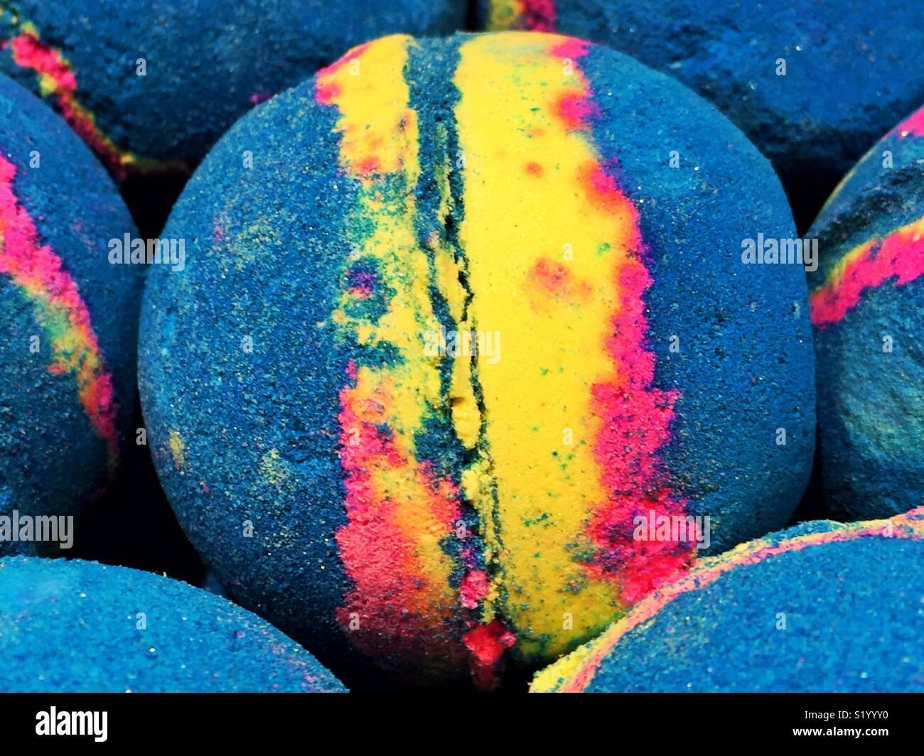 Neon colors on spherical bath bomb - Stock Image