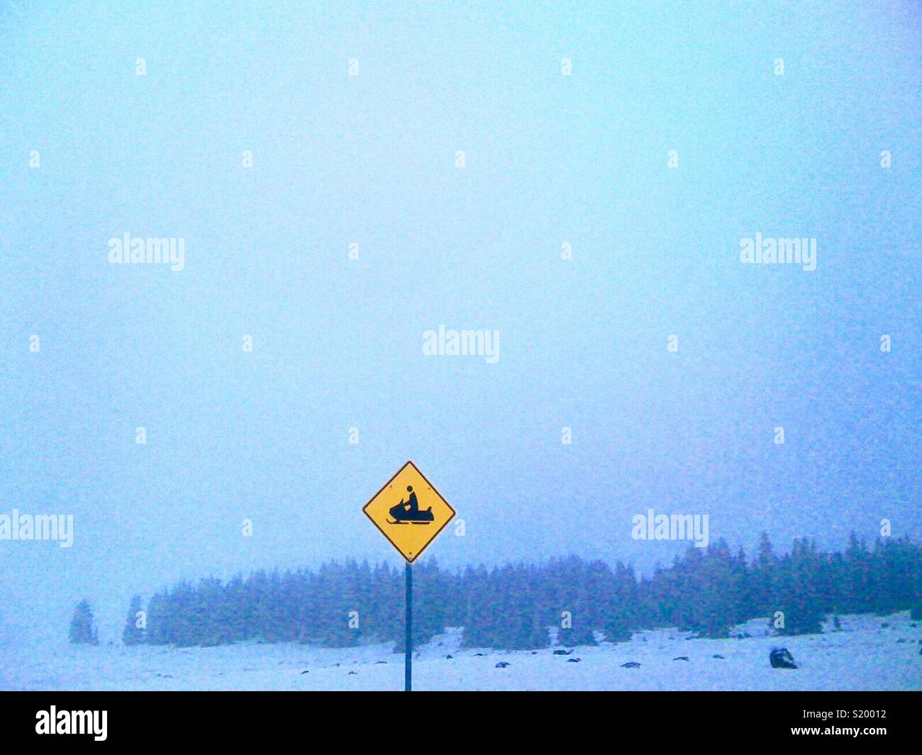 Snowmobile crossing sign. - Stock Image