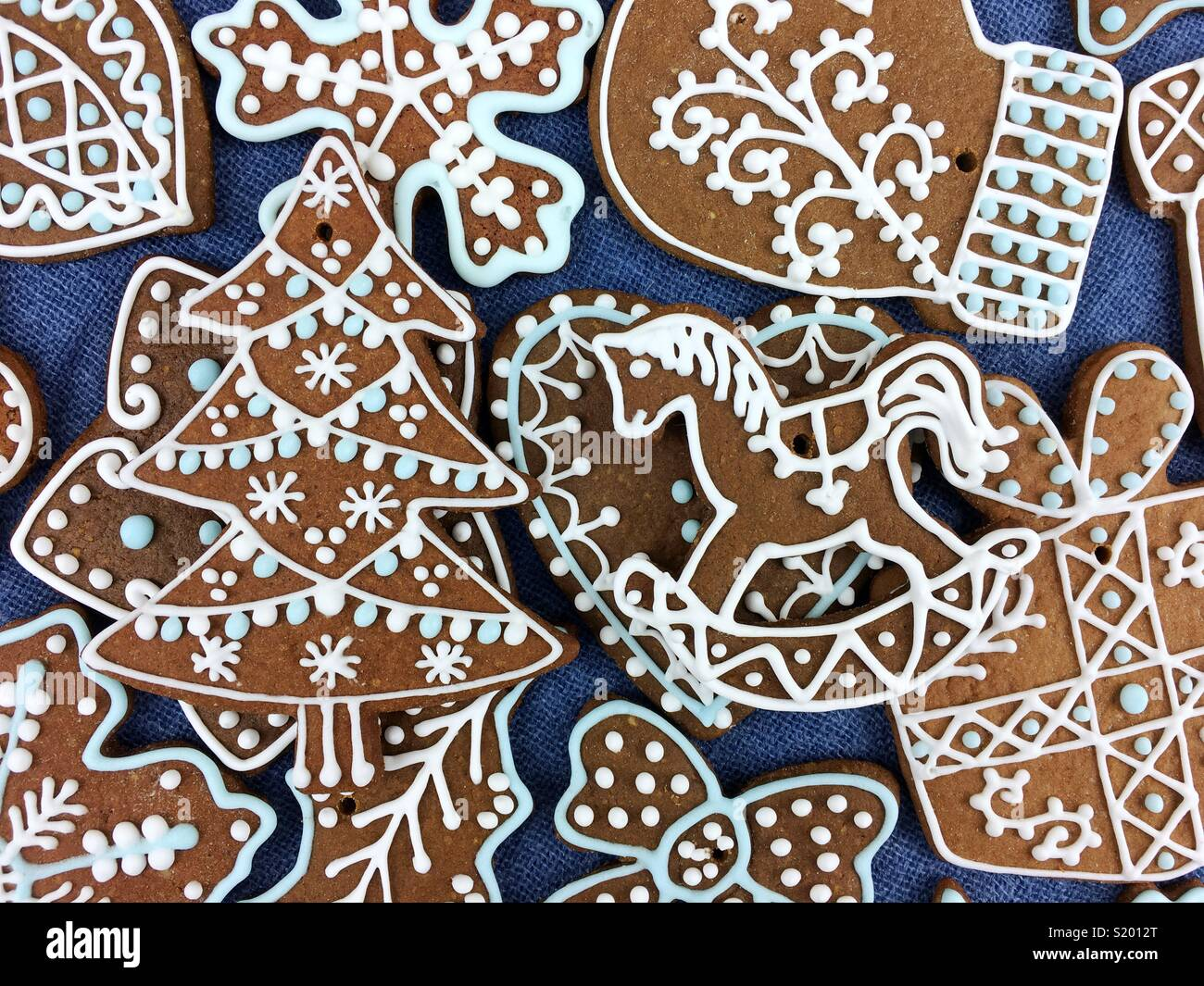 Christmas gingerbread cookie on a blue background - Stock Image