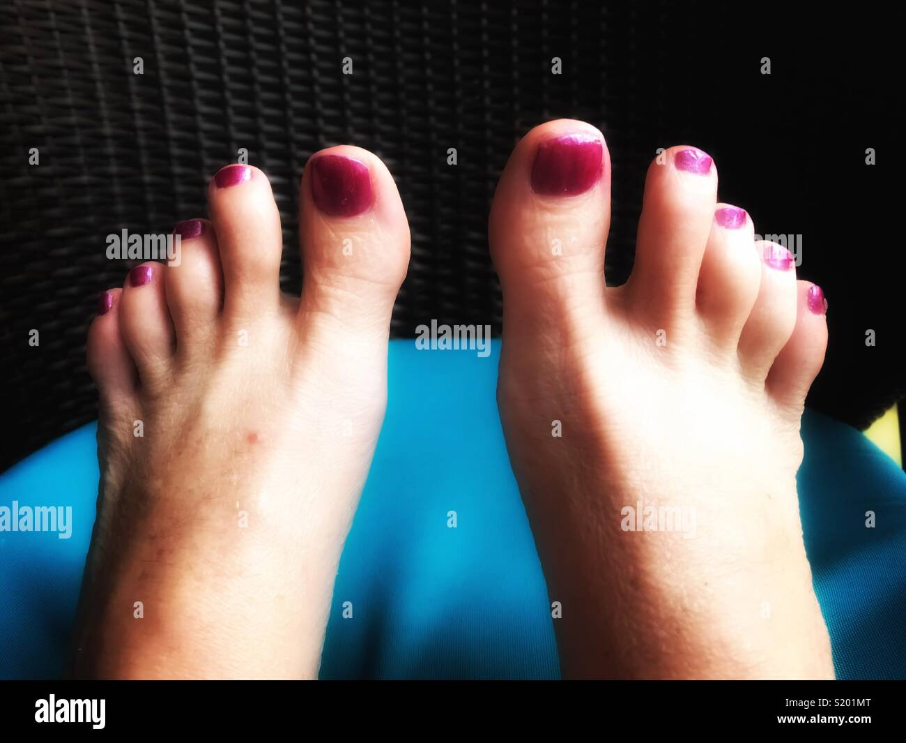 Bali holiday feet, wrinkles and painted nails - Stock Image