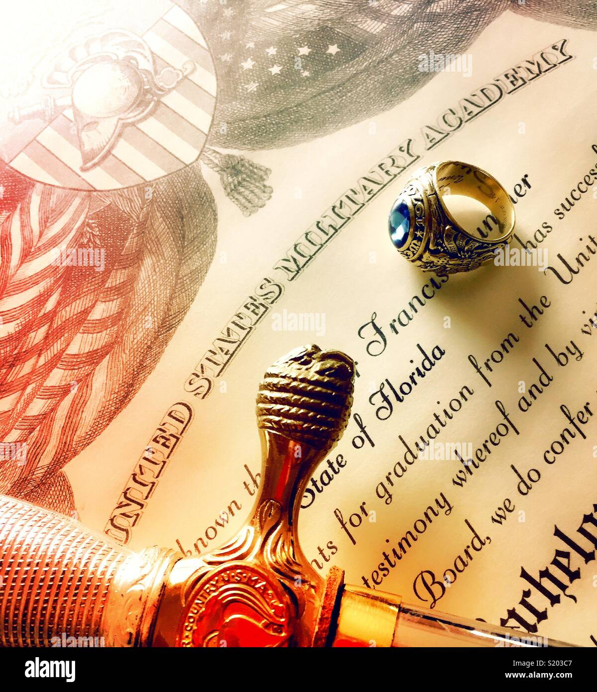 Ring and saber on west point diploma detail close-up, United States military Academy, USA - Stock Image