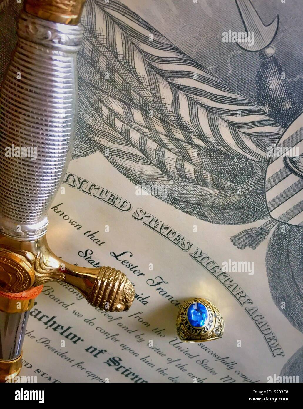 Cadet saber and graduate ring on United States military academy diploma still life, West Point , New York,  United States - Stock Image